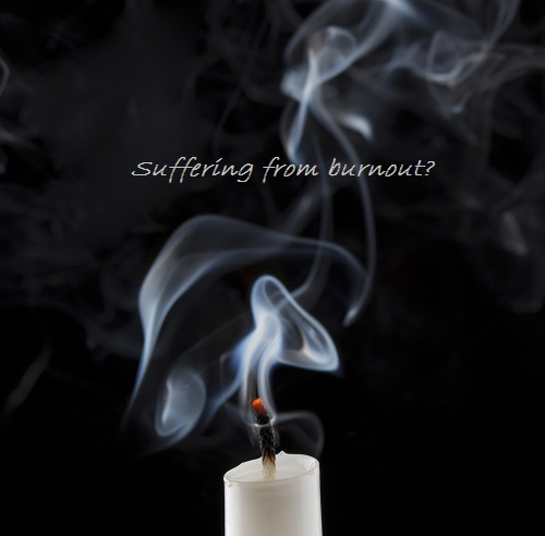 Swirling smoke from extinguished candle on black background
